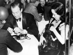 Merle Oberon gets acquainted with Blackie, a Cocker Spaniel she won at a weekly prize-fest at the Stork Club.