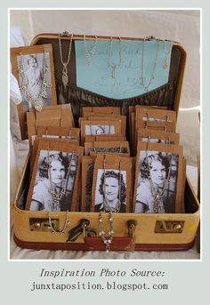 Jewelry Displayed in a vintage suitcase> Use Vintage photos for display cards…