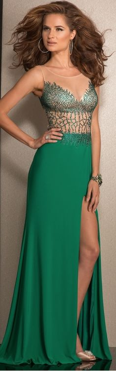 http://www.prom-avenue.com/clarisse-2617-prom-dress/Breathtaking prom dress featuring an illusion bodice with green crystals covering the bust and etching down the body to the top of the skirt. Crystals also wrap around the side to flow up over the shoulder blades and down around the top of the skirt.- shop prom-avenue