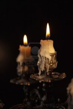 Bronze antique candlestick with burning candles in darkness #123rf #candle