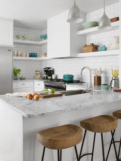 """A U-shaped layout was the only one that made sense for our space,"" says Danielle of her kitchen redesign. Because there are cabinets and counters on all three sides, Danielle never has to reach far when she's cooking or doing the dishes."