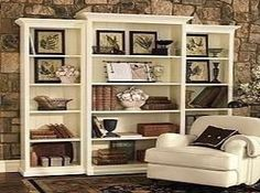 add crown moulding to the top and bottom of a cheap bookshelf - classy