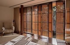 "I like the bamboo ""curtains"" on the glass doors. Rustic Shutters, Interior Window Shutters, Style At Home, California Shutters, Dream Mansion, Shutter Doors, Windows And Doors, Interior Architecture, Villa"