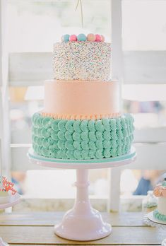 Brides.com: . Pastel colored tiers and a smattering of sprinkles make this…