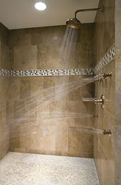 One nice thing about building a custom ceramic tile shower is that you can integrated multiple shower heads and jets as in this example.