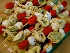 Fun Appetizer:  Tortellini Salad Kabobs. Finally a kabob that looks edible!!