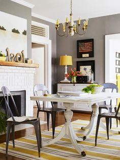 Gray walls pop of yellow cottage style room love these chairs. it is unbelievable how expensive they are!