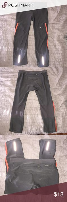Nike Dri-Fit Capri Legging Gently used, and only worn a handful times but in great condition. Only selling them because they're too small for me. Has a small back pocket for keys, chapstick etc. Has reflective stripes on front as shown in photos. Very comfortable and stretchy! Nike Pants Leggings