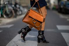 A tan leather Chloé Faye bag is paired with printed Isabel Marant boots