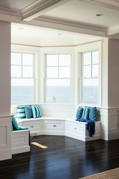 Built-in window seat with pillows to enjoy the ocean view