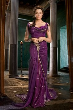 Lucy Lawless as Lucretia in Spartacus Vengeance (or Ursula's heroine, Rose Tolliver, dressed to compliment her husband, Lucius)