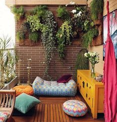 Here's a little inspiration for your terrace garden-cum-seating area. We love how floor pillows and poufs are used instead of a chair. A great space saving idea.   Photograph - Emily May