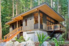 modern modular cabin with garage More