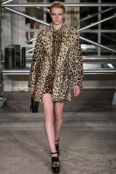 Love this jaunty leopard coat by Moschino Cheap and Chic. The buttoned up blouse, clunky shoes and rock n' roll hair and make-up keep the look edgy, not trashy.