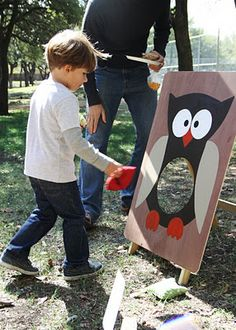 """hoot owl bean bag fling"" game from  woodland wonderland theme party"