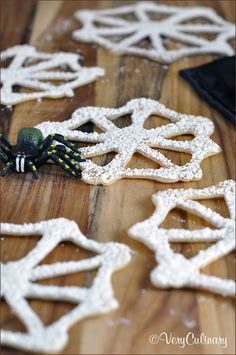 Creepy Cobweb Cookies | These free formed cookies are made out of a batter similar to that of pancakes which means you have to work quickly.  You can decorate the cookies by sprinkling them with powdered sugar or add chocolate chip spiders.