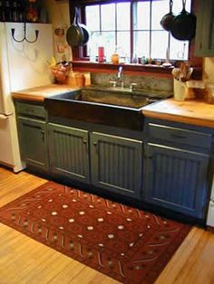 NOT blue cabinets, but this is the mountain kitchen, one side with the sink. Country blue bead-board kitchen cabinetry