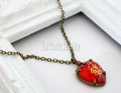 fun steampunk-inspired red heart necklace by LaTaniaJewelry