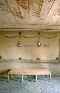 A pair of brass sconces is mounted above a simple bench in the hall which has a stone flagged floor and a painted wood ceiling Swedish Cottage, Swedish Decor, Swedish Style, Swedish House, Swedish Design, Nordic Design, Scandinavian Design, Swedish Interiors, Interior Architecture