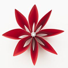 Fold A Paper Poinsettia To Top A Holiday Gift wow great idea. take card stock and fold. then attach with glue. then add a button? in the middle? sounds supper easy.