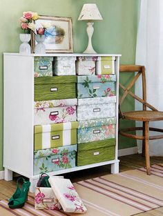 I am so loving this idea. There's a tutorial on how to cover the boxes, but I might use the pretty cloth covered boxes at Tuesday Morning, garage sales, etc.