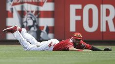 Cincinnati Reds center fielder Billy Hamilton misses a double hit by San Diego Padres' Matt Kemp in the third inning of a baseball game, Sunday, June 7, 2015, in Cincinnati.  -    © AP Photo/John Minchillo