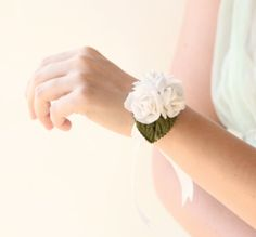 wrist corsage, bridal accessory, white rose, wedding flower. $15.00, via Etsy. Hannah: I'd love it if it had a baby blue ribbon for the bracelet power