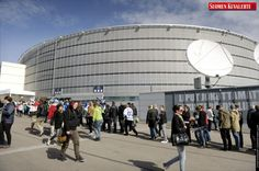 Spectators arrive for the match between USA and France, the opener of the 2012 IIHF Ice Hockey World Championships, in Helsinki,