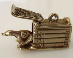 This is a superbly detailed heavy vintage 9ct gold articulated charm of a racing greyhound coming out of its trap poised to race. The trap has engraved numbers on one side and when the lever on the bottom is moved the door opens and the greyhound appears.  It weighs 4.7 grams, measures 1.6 cm by 1.2cm ( 5/8 inch by 1/2 inch) and is hallmarked G&H London Year 1964.