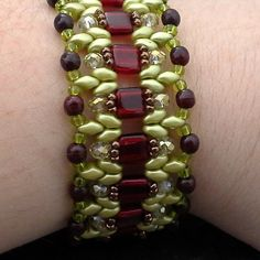 utorial. Double Needle RAW Czech 2 Hole Tile and Super Duo Beaded Floral Bracelet Pattern, Step by Step with Detailed Diagrams. design uses 4mm round, bicone, roundel or faceted beads. This design calls for both size 11 and size 8 seed beads.