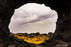 The portal to another planet: Dimmuborgir | Iceland.  One morning in September a year ago we fought the rain and went to a place with the exciting name Dimmuborgir in Iceland. The rain shifted between sustained rain and rain showers throughout the day. To be honest I didn't feel like I had something from there worth sharing. But this was a pleasant surprise!  Sony A7rII | 1/40 sec | f/8.0 | ISO 100 | 24 mm  #day #rain #gate #landscape #iceland #jani #rock #wall #overcast #view #yellow…