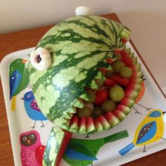 This watermelon shark is a great addition to a kids party table or summer BBQ. Filled with fruit, it makes a great healthy alternative to your traditional party food. You will need: Watermelon Lychees and red grapes for eyes Cocktail …