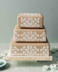 With a classic wedding pattern of intertwining rings and a Hawaiian design said to bring good luck, these creative wedding cakes enlist traditional quilting techniques. Fondant doubles as fabric, and piped icing stands in for stitches. The result is an heirloom that's too delicious to pass down.