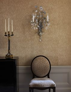 Elegant baguette sconces sparkle against warm upholstered walls in the formal dining room. Upholstered Walls, Wall Brackets, Elegant Homes, Side Chairs, Wall Sconces, Small Spaces, Museum, Wall Decor, Dining Rooms