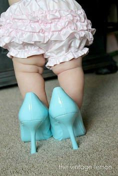 Haha, this reminds me of me when I was around that age. I used to wear my Mom's around our house. (Until I fell)  I still love high heels!
