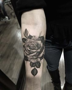 arm tattoo rose black and grey
