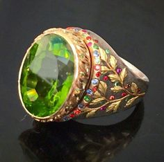 The Confetti For August birthdaysThis magnificent over 20 carat Burmese peridot ringis set in a hand engraved palladium mounting inlaid with 24k gold laurel leaves and colorful gems2 South Beach Street Nantucket  #jewelry #jewelrydesigner #design #rings #peridot #gems #art #chic #rare #elegant #engrave #engraver #enamel #inlay #nature #organic #nantucket #ack #nantucketphotos #nantucketwedding #gold #grand #beautiful