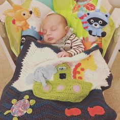 Day 12 #firsteverorder - My first order was for a Noah's Ark Blanket.  This pattern by Michele Wilcox has been extremely popular since (there's one on my hook just now). One of the best things about running a handmade business is when your customers send you photos.  Look at this gorgeous boy snuggled up under his new blankie.  Adorable.  #marchmeetthemaker #marchmeetthemaker12 #noahsark #crochet #crochetblanket #themedblanket #baby #capturemycraft #theveryhappyveggie #cute #sleepingbaby…