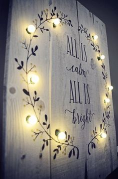 This hand-painted All is Calm All is Bright sign with lighted wreath on whitewashed salvaged wood measures 20 x 14  Includes battery powered warm