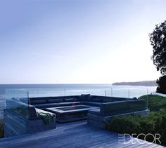 FIRE PITS & FIREPLACES: Summer Nights All Year Round     Courtney Cox's Malibu deck boasts a wrap-around seating area, complete with a teak, steel, and lava-rock-filled fire pit. Design by Cox in collaboration with Michael Kovac . Photo by Simon Upton.