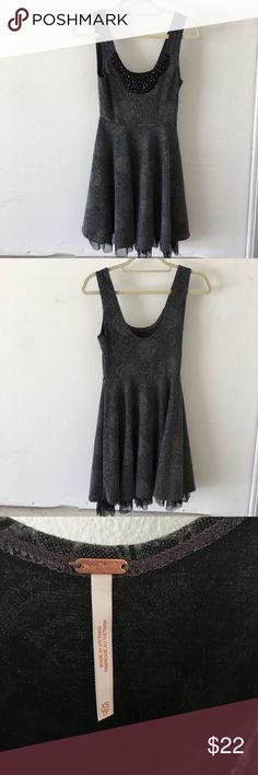 Free people scoop neck dress with tulle detail Very cute free people gray scoop neck dress with jewels on the chest and black tulle detailing at the skirt bottom. Worn and loved and still in good condition. Free People Dresses