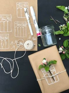 I use Bonne Maman jars for flowers, so I drew one with a Sharpie for a simple gift wrap. I tied a piece of kitchen twine and added a small flowering tree cutting. #bonnemaman #giftwrap #diygiftwrap