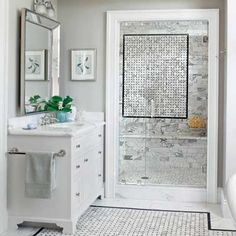The mosaic-tile inset in this master bath's shower echoes the one on the tile floor.