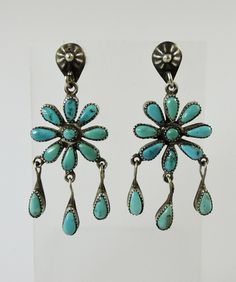 """Pretty turquoise flowers dangle from old style silver button posts. Vintage Zuni Indian jewelry of the 1950s, natural turquoise is slowly aging to various shades of blue. 3/4"""" wide rosettes with dangles, total length is 2"""". Pretty turquoise jewelry for Spring! Buyer pays $10.00 for shipping and insurance."""