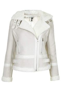 Love that Topshop has made a stylish sheepskin jacket that incorporates a hood with an on trend style.