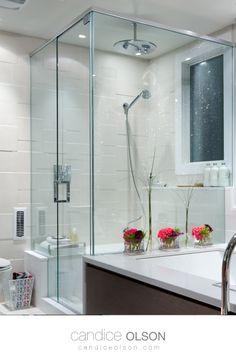 """Frameless glass shower • Rain Shower Head 14"""" • White Tile for the Bathroom • Built in Shower Seat • Built in Shower Shelf • #candiceolson #candiceolsondesign Rain Shower, Glass Shower, Built In Shower Seat, Candice Olson, Shower Shelves, White Tiles, Shower Heads, Creative Design, Bathrooms"""