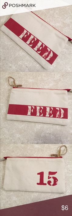 FEED 15 canvas red zipper pouch clutch This is a cotton zipper pouch from feed, one main compartment, zipper closure, red lining. Good size to be a clutch, wallet, or cosmetic pouch. See pictures for details. Good condition, small spot on back, see picture. Be sure and check out other items in closet and bundle to receive discounts. FEED Bags
