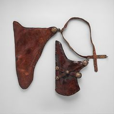 15-17th c. TIbetan or Mongolian Bow Case (25 x 16 1/2 in.), Quiver (20 x 11 1/2 in.), and Belt (50 3/4 x 1 1/4 in.), made of leather, black pigment, shellac, wood, iron, and gold - Met Museum 2003.344a-c