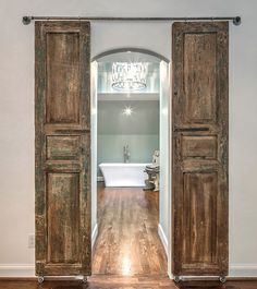 Make a doorway look wider with sliding shutters.