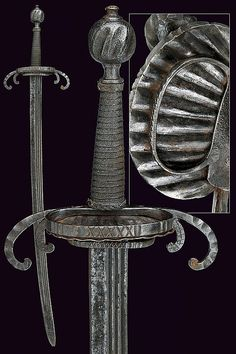 A crab-hilted sword, Italy, late 16th century. 	Curved blade with triple fuller; iron hilt with double quillons bent toward the blade, ring and shell-shaped guard; grip with metallic wire bindings; grooved pommel.  dimensions: length 85,5 cm.